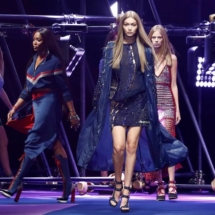 Models Gigi Hadid and Naomi Campbell present creations at the Versace fashion show during Milan Fashion Week Spring/Summer 2017 in Milan