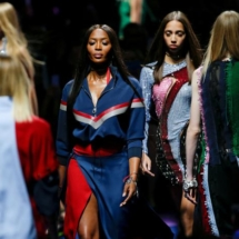 Supermodel Naomi Campbell presents a creation at the Versace fashion show during Milan Fashion Week Spring/Summer 2017 in Milan
